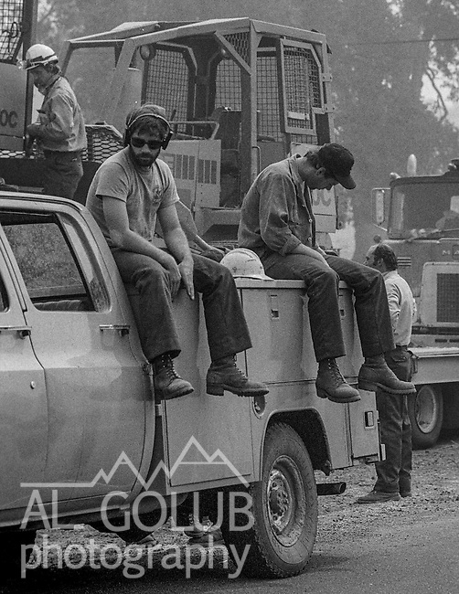 September 3, 1987 Buck Meadows, California -- Stanislaus Complex Fire -- Tired bulldozer operators rest while they can in fire camp. The Stanislaus Complex Fire consumed 28 structures and 145,980 acres.  One US Forest Service firefighter, David Ross Erickson, died from a tree-felling accident.