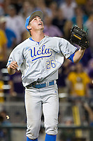 UCLA Bruin pitcher David Berg (26) watches a fly ball for the final out of Game 4 of the 2013 Men's College World Series against the LSU Tigers on June 16, 2013 at TD Ameritrade Park in Omaha, Nebraska. UCLA defeated LSU 2-1. (Andrew Woolley/Four Seam Images)