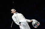 LONDON, ENGLAND - AUGUST 3:  Bongil Gu of Korea and celebrates winning his match during the Men's Fencing Team Sabre Bronze and Gold  Medal Final Day 7 of the London 2012 Olympic Games on August 3, 2012 at the Excell Center in London, England. (Photo by Donald Miralle)