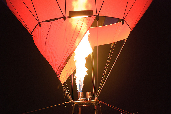 Flames fill Hot Air Balloons at Night