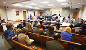 The defense and prosecution approach the bench prior to the jury being brought in court at the start of the third day of the penalty phase in the trial of convicted sniper John Allen Muhammad in Virginia Beach Circuit Court in Virginia Beach, Virginia on November 19, 2003.   Now in the punishment phase of the trial, the jury can only choose execution or life in prison without parole for Muhammad, who was found guilty Monday, November 17, 2003 of all charges, including two capital murder counts, in one of 10 fatal shootings that terrorized the Washington, D.C., area in 2002. <br /> Credit: Tracy Woodward - Pool via CNP
