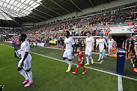 Pictured: Swansea players coming out of the tunnel. Saturday 23 August 2014<br />