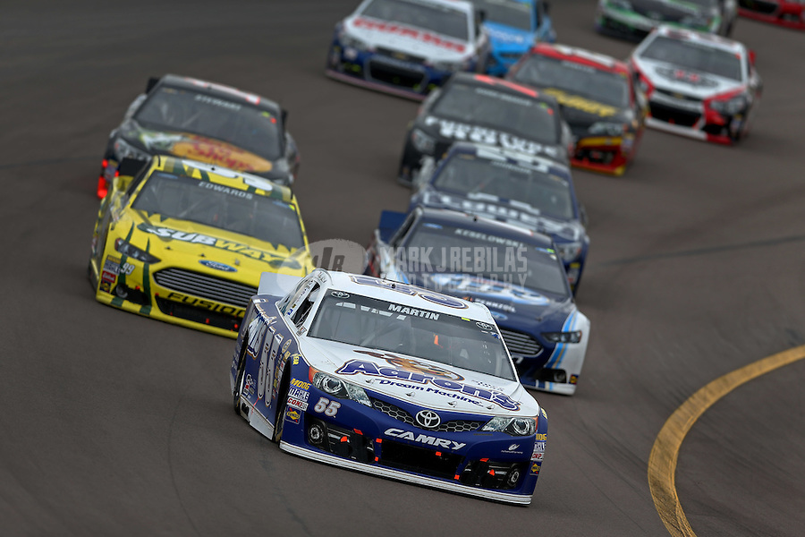 Mar. 3, 2013; Avondale, AZ, USA; NASCAR Sprint Cup Series driver Mark Martin leads a pack of cars during the Subway Fresh Fit 500 at Phoenix International Raceway. Mandatory Credit: Mark J. Rebilas-