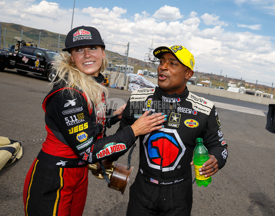 Jul 23, 2017; Morrison, CO, USA; NHRA top fuel driver Leah Pritchett (left) congratulates teammate and race winner Antron Brown as he celebrates following the Mile High Nationals at Bandimere Speedway. Mandatory Credit: Mark J. Rebilas-USA TODAY Sports