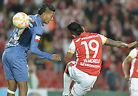 BOGOTÁ - COLOMBIA -29-09-2015: Wilson Morelo (Der) jugador de Independiente Santa Fe (COL) disputa el balón con John Narvaez (Izq) jugador de Emelec (ECU) durante partido de vuelta por octavos de final, llave C, de la Copa Sudamericana 2015 jugado en el estadio Nemesio Camacho El Campín de la ciudad de Bogota./ Wilson Morelo (R) player of Independiente Santa Fe (COL) vies for the ball with John Narvaez (L) player of Emelec (ECU) during the second leg match for the knockout stages, key C, of the Copa Sudamericana 2015 played at Nemesio Camacho El Campin stadium in Bogota city.  Photo: VizzorImage/ Gabriel Aponte /Staff