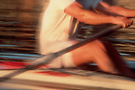 Rowing, well-muscled male rower in blur motion, single racing shell, Lake Union, Seattle,
