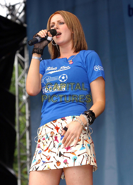 ALEXIS STRUM.96.4 BRBM's Party in the Park .sales@capitalpictures.com.www.capitalpictures.com.©Capital Pictures.music, singing, live, concert, stage, blue t-shirt, guitar patterned skirt, fingerless glove