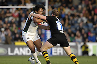 Wycombe, Great Britain, left Exiles, Seilala MAPUSUA, tackled by Wasps, Tom REES, during the EDF Energy, Anglo Welsh, rugby Cup match, London Wasps vs London Irish,  at Adams Park, England, 08/10/2006. [Photo, Peter Spurrier/Intersport-images]....
