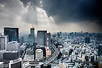 Tokyo, June 24 2013 - Stormy weather over the city, with the Otemachi area in the foreground (left) and the Shinjuku area in the background (left)