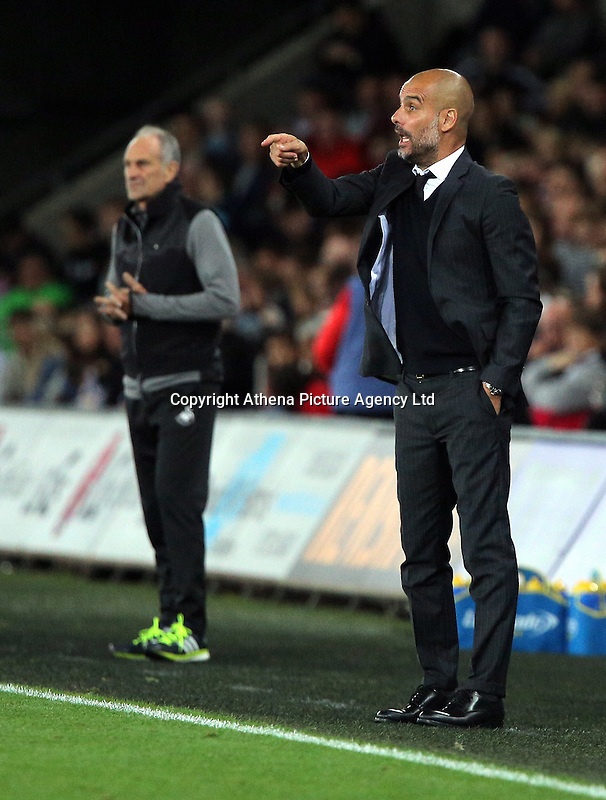 (L-R) Francesco Guidolin, manager of Swansea City and Manager of manchester City, Pep Guardiola during the EFL Cup Third Round match between Swansea City and Manchester City at The Liberty Stadium in Swansea, Wales, UK. Wednesday 21 September.
