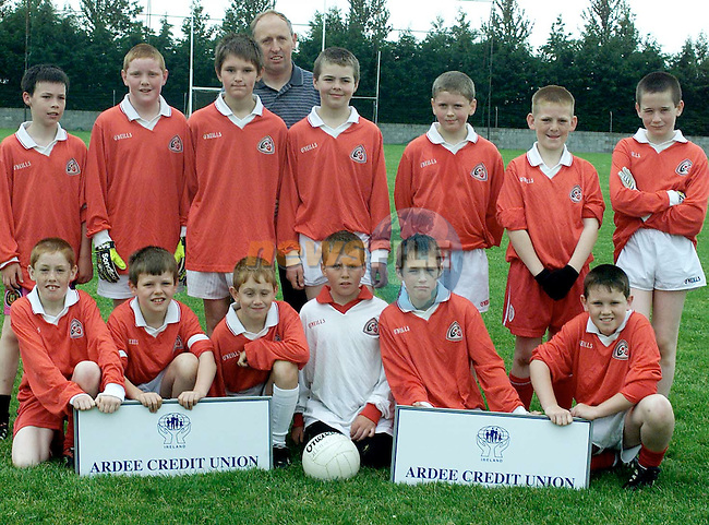 Kieran Matthews, Manager with the Hunterstown team who took part in the Ardee Credit Union U/12 Blitz held in the Ardee St. Mary's GAA grounds. Included are (Front L-R) Martin Lennon, David Finn, Gareth Callan, Declan Nulty, Ciaran McCann and Shane Lynch. (Back L-R) Lorcan Farrell, Ruairi Murphy, Noel McCann, Matthew Matthews, Conor Matthews, Cathal McKenna and Paul McGrory.