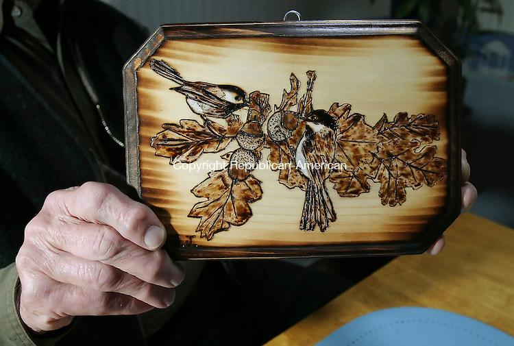 NAUGATUCK, CT 4/2/07- 040207BZ04- Frank Szczesiul, of Naugatuck, holds a picture of birds he made.<br /> Jamison C. Bazinet Republican-American