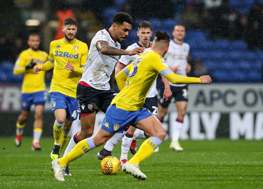 Bolton Wanderers' Josh Magennis breaks under pressure from Leeds United's Kalvin Phillips <br /> <br /> Photographer Andrew Kearns/CameraSport<br /> <br /> The EFL Sky Bet Championship - Bolton Wanderers v Leeds United - Saturday 15th December 2018 - University of Bolton Stadium - Bolton<br /> <br /> World Copyright © 2018 CameraSport. All rights reserved. 43 Linden Ave. Countesthorpe. Leicester. England. LE8 5PG - Tel: +44 (0) 116 277 4147 - admin@camerasport.com - www.camerasport.com