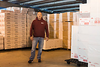 Mark Barlow is the co-owner of Island Seafood, a lobster dealer in Eliot, Maine, USA, seen here among empty boxes prepared for shipping live lobsters in Island Seafood's packaging facility, on Wed., Jan. 18, 2018.