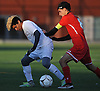 Jelson Bonilla #5 of Glen Cove, left, gets pressured by Giancarlo Vacca #8 of Plainedge during the Nassau County Class A varsity boys soccer semifinals at Adelphi University on Friday, Oct. 28, 2016.