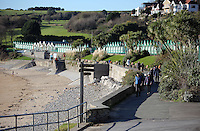 WEATHER PICTURE<br />Pictured: People enjoy the sunshine strolling in Langland Bay near in Swansea, south Wales, UK. Tuesday 29 November 2016<br />Re: Temperatures close to freezing affect parts of England and Wales.
