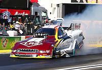 Feb 6, 2015; Pomona, CA, USA; NHRA funny car driver Tim Wilkerson during qualifying for the Winternationals at Auto Club Raceway at Pomona. Mandatory Credit: Mark J. Rebilas-