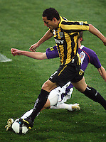 Perth's Scott Neville tackles Leo Bertos during the A-League football match between Wellington Phoenix and Perth Glory at Westpac Stadium, Wellington, New Zealand on Sunday, 16 August 2009. Photo: Dave Lintott / lintottphoto.co.nz