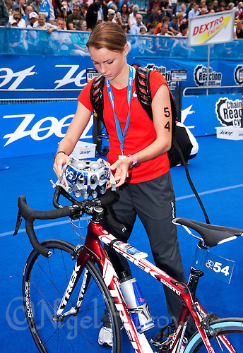 17 JUL 2011 - HAMBURG, GER - Kirsten Sweetland (CAN) prepares her bike in transition before the start of the women's Hamburg round of triathlon's ITU World Championship Series .(PHOTO (C) NIGEL FARROW)