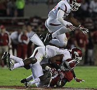 Arkansas Democrat-Gazette/BENJAMIN KRAIN --10/10/15--<br /> Alabama wide receiver Calvin Ridley (3) is tackled by Arkansas defensive back Henre&rsquo; Toliver (5) and Arkansas defensive back Rohan Gaines (26) during their game in Tuscaloosa.