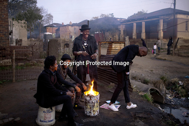 SOWETO, SOUTH AFRICA MAY 21: Members of the designer group Smarteez during a photo shoot on May 21, 2013 in Kliptown section of Soweto, South Africa. They did a photo shoot together with a new collection. From left, Teekay Makwale, Floyd Avenue. Sibu Sithole and Lethabo Tsatsinyane. They are trying to break into the local fashion scene. Soweto today is a mix of old housing and newly constructed townhouses. A new hungry black middle-class is growing steadily. Many residents work in Johannesburg but the last years many shopping malls have been built, and people are starting to spend their money in Soweto. (Photo by: Per-Anders Pettersson)