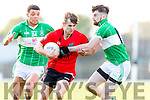 No 30 Glenbeigh/Glencar burst past Na Gaeil duo Stefan Okunbor and Dylan Brazil during the Junior Premier final in Fitzgerald Stadium on Sunday