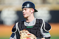 Marshall Thundering Herd catcher Travis Wildermuth (20) during infield practice prior to the game against the Georgetown Hoyas at Wake Forest Baseball Park on February 15, 2014 in Winston-Salem, North Carolina.  The Thundering Herd defeated the Hoyas 5-1.  (Brian Westerholt/Four Seam Images)