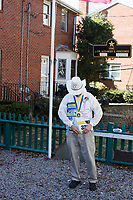 Carlos Arredondo, 57, is seen in his front yard in Roslindale, Boston, Massachusetts, USA, on Sat., March 31, 2018. Arredondo is well known as the &quot;man in the cowboy hat&quot; who helped out in the aftermath of the Boston Marathon Bombing in 2013. Carlos is wearing a jacket that he has used to create a t-shirt design for when he runs the Boston Marathon later this year. Though he has run the race unofficially previously, this will be the first time he runs it &quot;legally,&quot; he says.<br /> <br /> Behind Carlos is a memorial to his two sons,  Marine Lance Corporal Alexander Scott Arredondo and Brian Arredondo. Alex was killed while serving in Iraq in 2004, and Brian died by suicide in 2011.