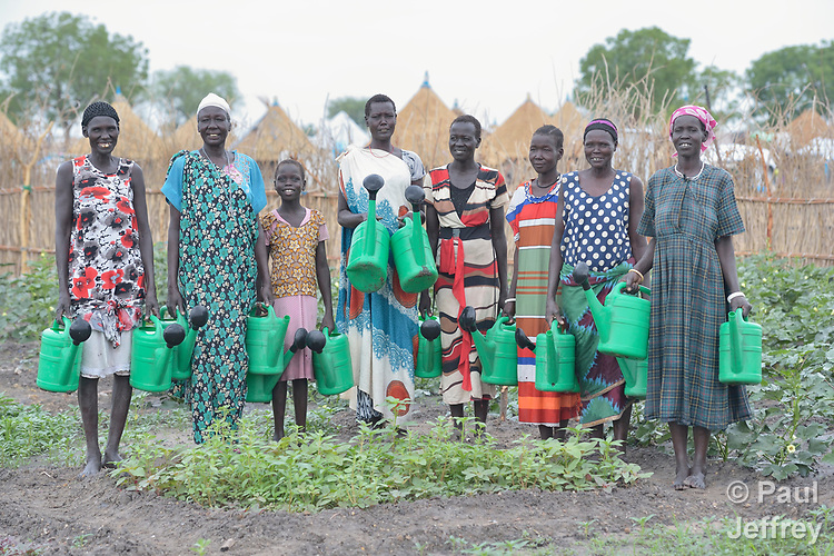 A group of women pose in their communal vegetable garden in Poktap, a town in South Sudan's Jonglei State where conflict, drought and inflation have caused severe food insecurity. Most families in the town have just returned from years of displacement. The Lutheran World Federation, a member of the ACT Alliance, is helping families tackle food problems, and provided seeds and tools to help the women start the garden.