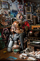 BNPS.co.uk (01202 558833)<br /> Pic: PhilYeomans/BNPS<br /> <br /> Ray Ives Locker<br /> <br /> Old man of the sea Ray Ives has opened his very own Davy Jones' locker of hundreds of nautical treasures he has salvaged from the seabed.<br /> <br /> Ray(77) has spent 40 years amassing a huge trove of historical artefacts that he has found during thousands of deep sea dives off the British coast.<br /> <br /> Ray's watery Aladdins cave includes canon balls, muskets, swords and even the bell from an ocean liner sunk by a German U-boat in the First World War.<br /> <br /> For years Ray had stuffed his collection into a tiny shed in the back garden of his home in Plymouth, Devon.<br /> <br /> But now the fascinating archive has now gone on display to the public in a ramshackle museum made from shipping containers.