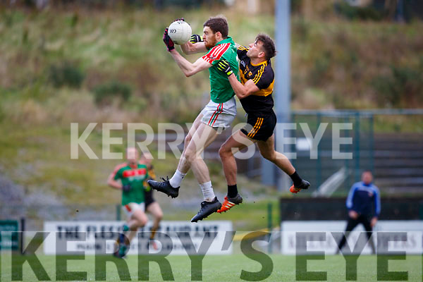 Donal Maher Kilcummingets to the ball ahead of Michael Burns Dr Crokes during their O'Donoghue cup SF in Lewis Rd on Saturday