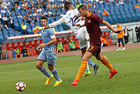 Calcio, Serie A: Roma vs Sampdoria. Roma, stadio Olimpico, 11 settembre 2016.<br /> Roma&rsquo;s Edin Dzeko, right, kicks to score during the Italian Serie A football match between Roma and Sampdoria at Rome's Olympic stadium, 11 September 2016. Roma won 3-2.<br /> UPDATE IMAGES PRESS/Riccardo De Luca