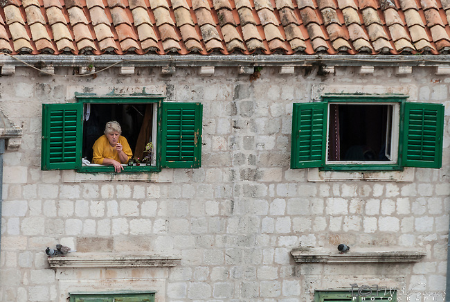 Local in the old town of Dubrovnik, Croatia.