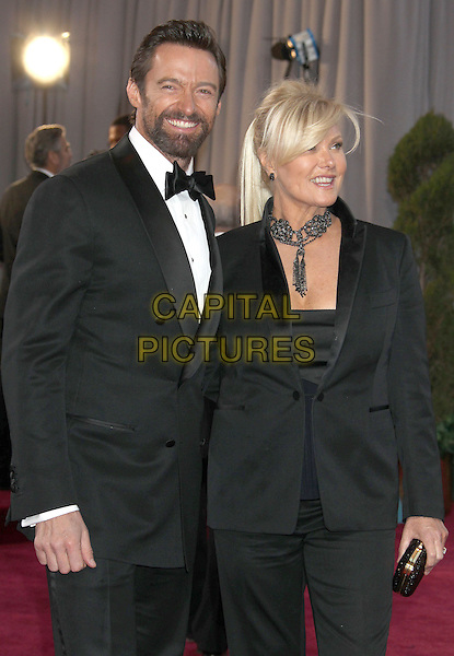 Hugh Jackman and Deborra-Lee Furness.85th Annual Academy Awards held at the Dolby Theatre at Hollywood & Highland Center, Hollywood, California, USA..February 24th, 2013.oscars half length black white shirt tuxedo blazer necklace beard facial hair.CAP/ADM/RE.©Russ Elliot/AdMedia/Capital Pictures.