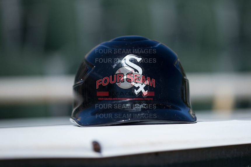A Chicago White Sox helmet sits on top of the dugout during the Kannapolis Intimidators preseason workout at Kannapolis Intimidators Stadium on April 5, 2016 in Kannapolis, North Carolina.  (Brian Westerholt/Four Seam Images)