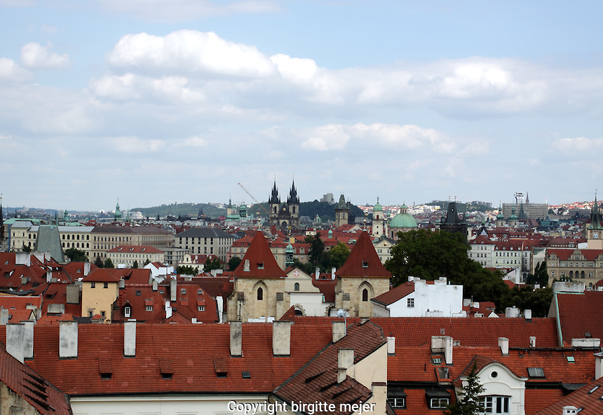 View over the red tile roofs of Prague, with the Church of our Lady Tyn in the center background.