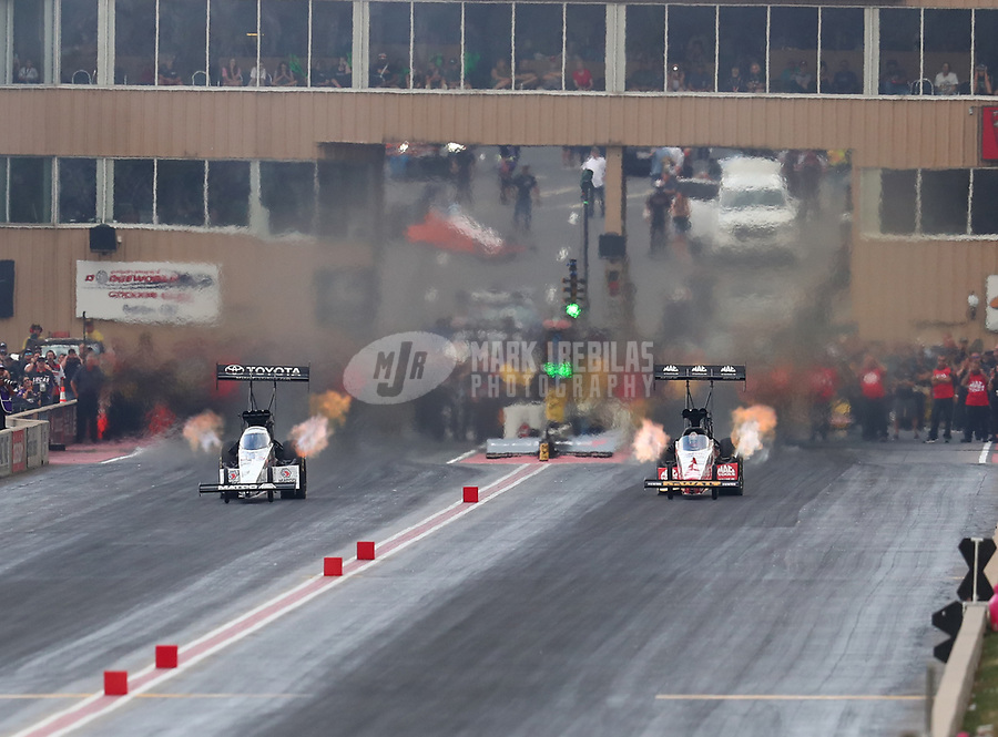 Jul 21, 2018; Morrison, CO, USA; NHRA top fuel driver Antron Brown (left) races alongside Doug Kalitta during qualifying for the Mile High Nationals at Bandimere Speedway. Mandatory Credit: Mark J. Rebilas-USA TODAY Sports