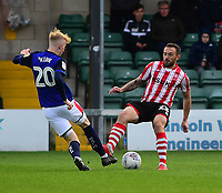 Lincoln City's Neal Eardley vies for possession with  Crewe Alexandra's Charlie Kirk<br /> <br /> Photographer Andrew Vaughan/CameraSport<br /> <br /> The EFL Sky Bet League Two - Lincoln City v Crewe Alexandra - Saturday 6th October 2018 - Sincil Bank - Lincoln<br /> <br /> World Copyright &copy; 2018 CameraSport. All rights reserved. 43 Linden Ave. Countesthorpe. Leicester. England. LE8 5PG - Tel: +44 (0) 116 277 4147 - admin@camerasport.com - www.camerasport.com