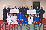 CHEQUE PRESENTATION: Member's of IT Tralee Judo club presenting John Daly (IT Tralee charities) and Niall Harty (Raise & Give charities students union) for ?500 each at the IT South campus on Monday front l-r: Danny Roche, Amy Madigan-Cooke, John Griffin, Emma Fitzgerald, Kirsty McCrea and J T Deenihan. Back l-r: Daniel O'Loughlin, Daelyn Purcell, John Daly (IT Tralee charities), Brennain Gould-Duff, Sven Rosery, Stephen O'Reilly, Niall Harty (Raise & Give charities students union), Jamie Kevany-McMahon and Mahdi Baba.