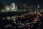 Floating candle lanterns fill a river on August 6, 2015, in Hiroshima, Japan, in front of the city's atomic bomb dome. The lanterns, thousands of which were launched on the 70th anniversary of the atomic bombing of the city, carry handmade messages and drawings, conveying each person's prayers for peace and comfort for the victims of the violence.