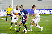 Alex Muyl (23) of the USA  is defended by Richmond McCarthy (20) and Bryan Gallego (4) of the New York Red Bulls. The USMNT U-17 defeated New York Red Bulls U-18 4-1 during a friendly at Red Bull Arena in Harrison, NJ, on October 09, 2010.