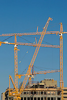 Steel beams are lowered into place for a new high rise in Charlotte, NC.