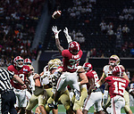 Alabama linebacker Rashaan Evans (32) goes up to recover a blocked Florida State field goal attempt to end the first half of the Chick-fil-A Kickoff game at the new Mercedes-Benz Stadium in Atlanta, Georgia on September 2, 2017.   Photo by Mark Wallheiser/UPI