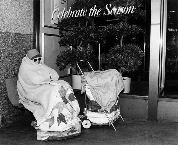 Homeless woman sleeping outside Filene's Department Store on Washington Street Boston MA 1989
