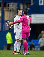 Goalkeeper Ryan Allsop (Loanee from Bournemouth) of Wycombe Wanderers shakes hands with Goalkeeper Paul Jones of Portsmouth at the final whistle during the Sky Bet League 2 match between Portsmouth and Wycombe Wanderers at Fratton Park, Portsmouth, England on 23 April 2016. Photo by Andy Rowland.