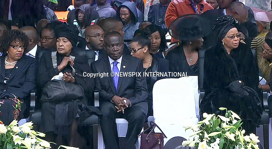 WINNIE MANDELA AND NELSON'S WIDOW GRACA MACHEL(right)<br /> NELSON MANDELA MEMORIAL<br /> The nation mourns Nelson Rolihlahla Mandela Memorial Service, FNB Stadium, Johannesburg, South Africa<br /> Mandatory Credit Photo: &copy;NEWSPIX INTERNATIONAL<br /> <br /> **ALL FEES PAYABLE TO: &quot;NEWSPIX INTERNATIONAL&quot;**<br /> <br /> IMMEDIATE CONFIRMATION OF USAGE REQUIRED:<br /> Newspix International, 31 Chinnery Hill, Bishop's Stortford, ENGLAND CM23 3PS<br /> Tel:+441279 324672  ; Fax: +441279656877<br /> Mobile:  07775681153<br /> e-mail: info@newspixinternational.co.uk