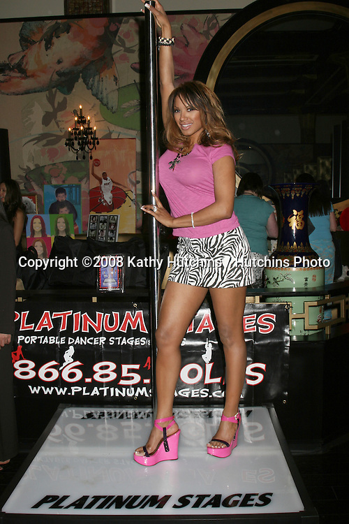 Traci Bingham on the Platinum Stages stripper pole.GBK MTV Movie Awards Gifting Suites .Crimson & Opera.Los Angeles,  CA.May 30, 2008.©2008 Kathy Hutchins / Hutchins Photo .