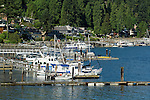 Private jetty and boat marina overlooked by homes in Deep Cove, Burrard Inlet,Vancouver, British Columbia, Canada.
