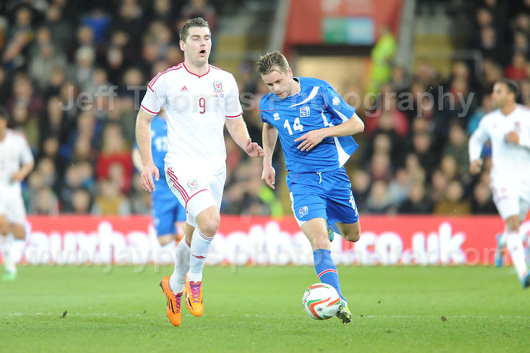 Sam Vokes of Wales and Kari Arnason of Iceland challenge each other for the ball. Cardiff City Stadium, Cardiff, Wales, Wednesday 5th March 2014. The Football Association of Wales - Vauxhall International Friendly - Wales v Iceland. Pictures by Jeff Thomas Photography - www.jaypics.photoshelter.com - Contact: thomastwotimes@live.co.uk - 07837 386244