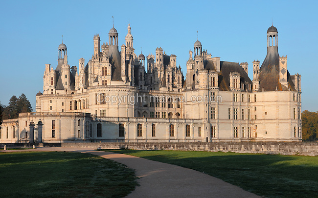 Chateau de Chambord, designed by Domenico da Cortona and built 1519-47 in French Renaissance style under King Francois I, at Chambord, Loir-et-Cher, France. The largest of the Loire Valley chateaux, Chambord has a central keep with 4 bastion towers on the corners, a moat and an elaborate decorative roofline. The chateau was listed as a UNESCO World Heritage Site in 1981. Picture by Manuel Cohen